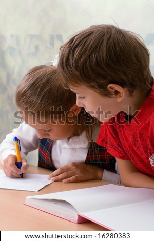 Elementary school. Two pupils in classroom. - stock photo