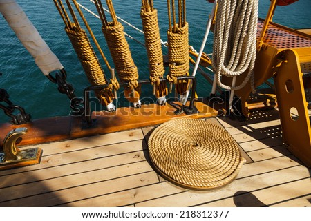 Elements of equipment of a old sailing vessel on the background of sea. - stock photo