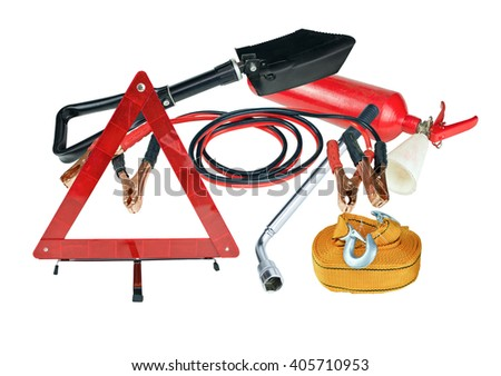 Elements of the essentials for a passenger car. Danger Safety Warning Triangle Sign, towing rope, fire extinguisher, Jumper cable, wheel wrench and shovel - stock photo