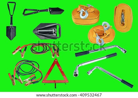 Elements of the essentials for a passenger car. Danger Safety Warning Triangle Sign, towing rope, fire extinguisher, Jumper cable, wheel wrench and shovel. Green screen, chroma key. - stock photo