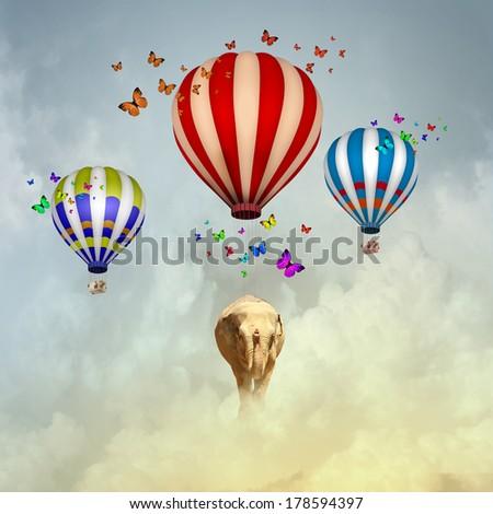 Elephant flying in sky on colorful aerostat - stock photo