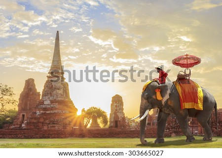 Elephant for Tourists on an ride tour of the ancient city in sunrise background - stock photo