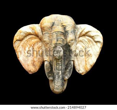 Elephant head statue isolated on black background. - stock photo