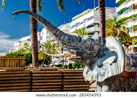 Elephant shower on the Marbella beach. Marbella is a resort city in southern Spain