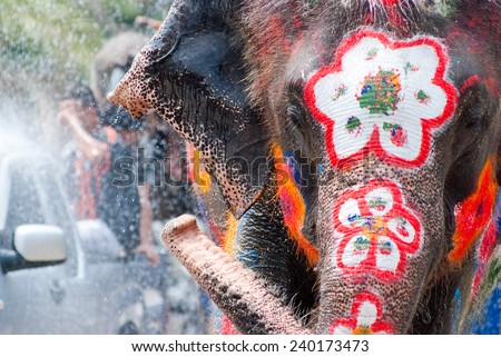 Elephant splashing water during Songkran Festival on Apr 14, 2014 in Ayutthaya, Thailand.  Initiated by Tourism Authority of Thailand, elephants take part in the festival to give revelers more fun. - stock photo