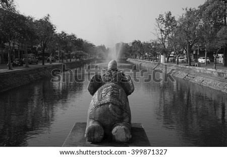 Elephant statue at chiangmai downtown canal(Black and white) - stock photo