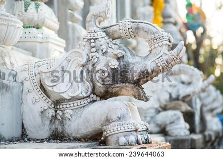 Elephant Statue decorate entrance of thai temple - stock photo