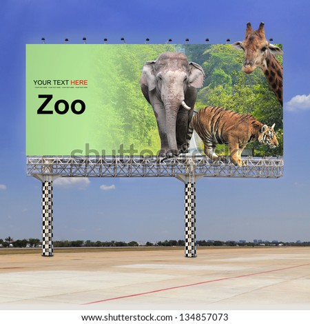 Elephant, tiger and giraffe in the zoo on outdoor billboard - stock photo