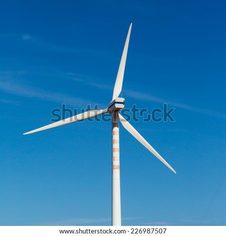 Eletric Power Generator, wind turbine over blue Sky - stock photo