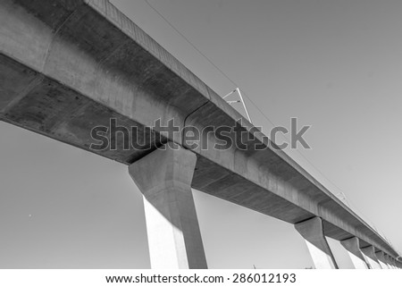 elevated sky train railway in black and white - stock photo