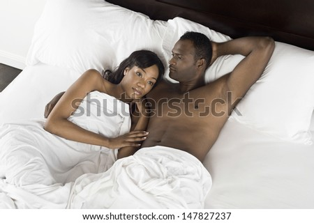 Elevated view of an African American couple lying in bed - stock photo