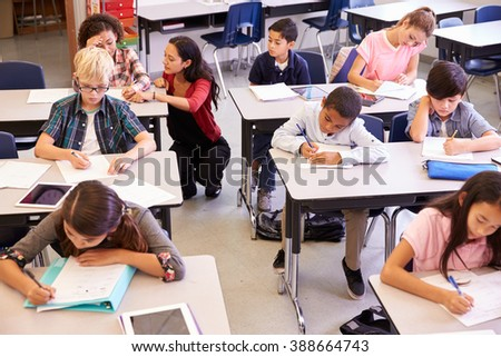 Elevated view of teacher and kids in elementary school class - stock photo