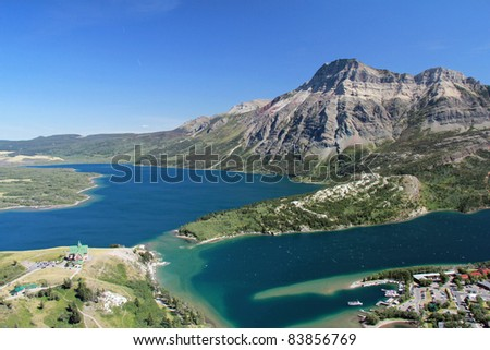 Elevated View of Waterton and Waterton Lakes from Mountain Trail - Waterton Lakes National Park, Alberta, Canada - stock photo