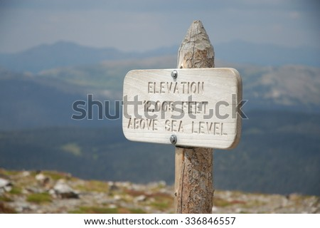 elevation sign post in rocky mountain national park - stock photo