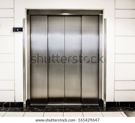 elevator door in a modern building - stock photo