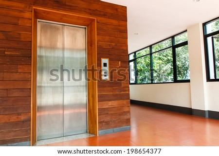 Elevator with two silver door in building - stock photo