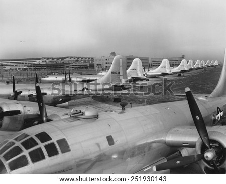 Eleven B-29's in Boeing-Wichita assembly factory awaiting final flight tests. The 'Superfortresses' were introduced to combat in May 1944, mainly in the Pacific as long range bombers against Japan. - stock photo