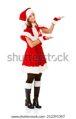 Elf: Cute Santa Girl Gestures To Side - stock photo
