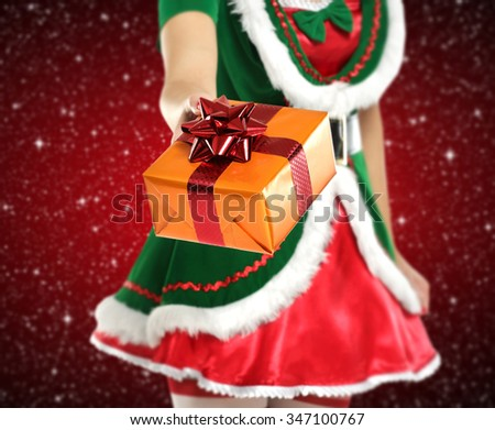 elf lady and gift  - stock photo