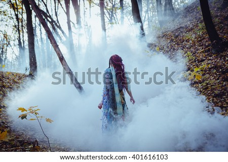 Elf woman in a magical forest - stock photo
