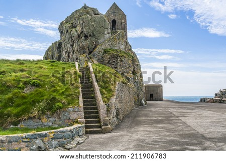 Elizabeth Castle (1594) - castle & tourist attraction on a tidal island within parish of Saint Helier, Jersey, UK. It is named after Elizabeth I who was queen of England at time when castle was built. - stock photo