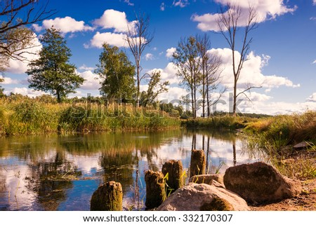 Elk River in end of summer.  Masuria, Poland. - stock photo