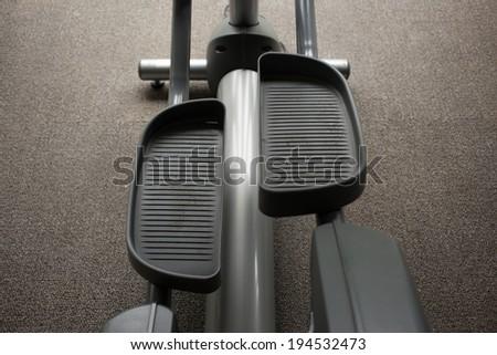 Elliptical cross trainer machine in exercise room for sport - stock photo