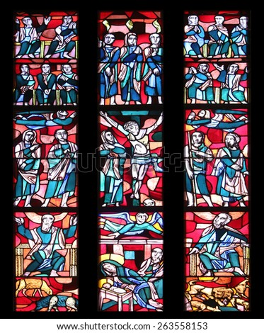 ELLWANGEN, GERMANY - MAY 07: Stained glass window in Basilica of St. Vitus in Ellwangen, Germany on May 07, 2014. - stock photo