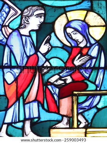 ELLWANGEN, GERMANY - MAY 07: The Annunciation, Stained glass window in Basilica of St. Vitus in Ellwangen, Germany on May 07, 2014. - stock photo