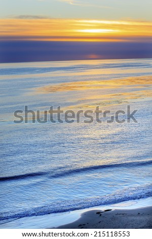 Ellwood Mesa Coastline Pacific Ocean Orange Sunset Goleta California - stock photo