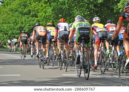 ELSPEET, THE NETHERLANDS, 3 JUNE 2015 - Cyclists racing through Elspeet during the national cycling race 'Parel van de Veluwe'. - stock photo