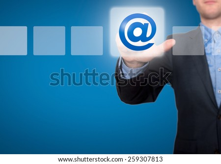 Email and contact symbols in front of businessman - Stock Image - stock photo