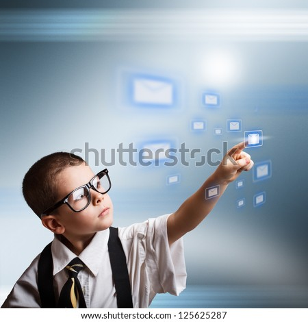 Email concept with little business boy dressed in oversized suit clothes - stock photo
