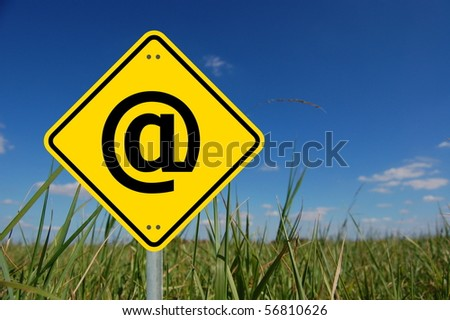 email concept with yellow road sign and copyspace for text message - stock photo