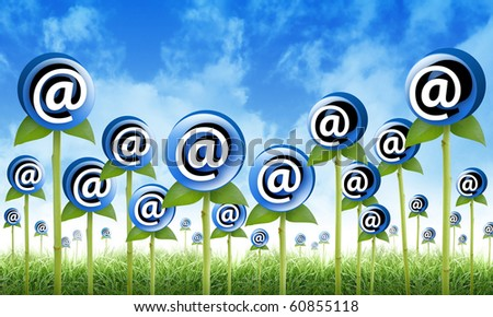 Email Flowers are sprouting for a internet, newsletter inbox contact theme. The flowers have an at symbol to signify an email address. Also use it for a spam or marketing concept - stock photo
