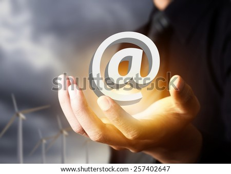 Email icon in businessman hand, contact us - stock photo
