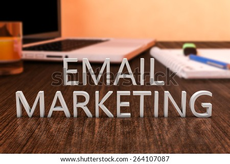 Email Marketing - letters on wooden desk with laptop computer and a notebook. 3d render illustration. - stock photo