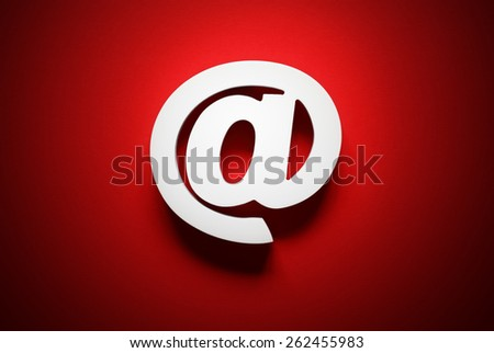 Email symbol on red background concept for internet, contact and e-mail address - stock photo