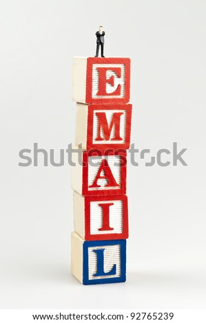 Email word and toy business man - stock photo