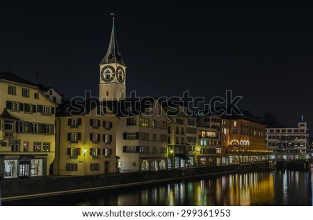 embankment of Limmat river with historic houses in Zurich center in evening, Switzerland - stock photo
