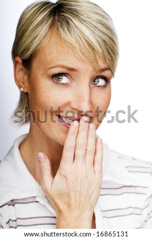 embarrassed young blond woman close up shoot - stock photo