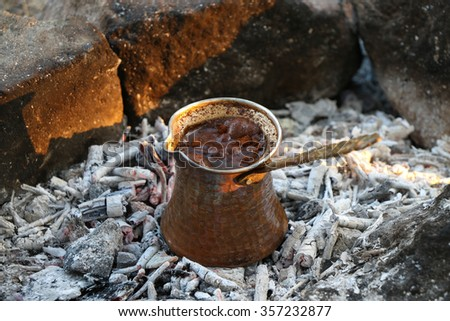 Ember / roasted Turkish coffee on the coal. - stock photo