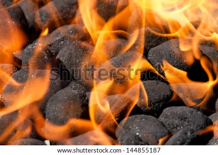 embers and blazing fire on a bbq grill - stock photo