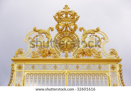 The french monarchy over the gate to versailles, france - stock photo