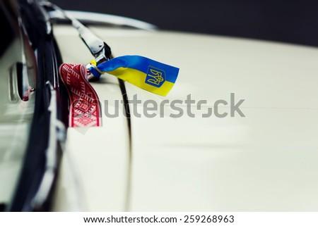 emblem of ukraine on the car - stock photo