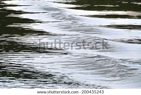 Embossed contrast waves: gleams, reflexes and half-shades on the water surface. Waves: relief on the water surface, a series of images - stock photo