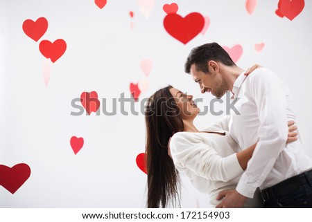 Embraces couple in love with hearts - stock photo