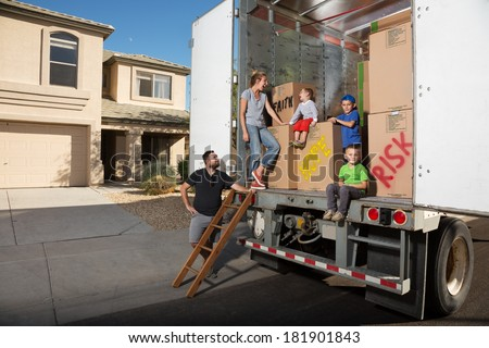 Embracing Change.  A Family Displays Excitement as they Prepare to Relocate. - stock photo