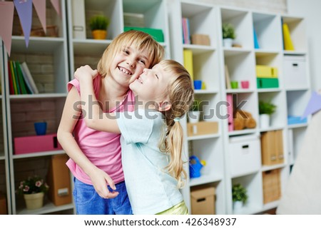 Embracing sister - stock photo