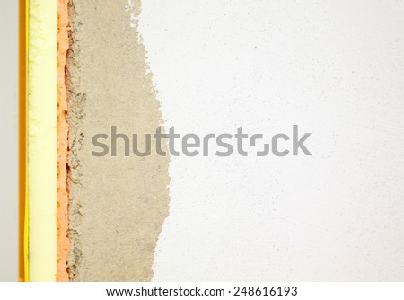 Embrasures insulationand stucco wall texture - stock photo